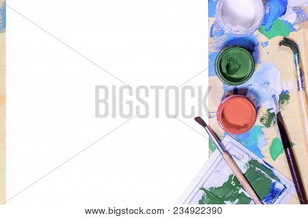 Color Gouache Jars On White Background. Top View, Copy Space.