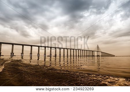 Bridge Over Sea In Manaus, Brazil. Road Passage Over Water On Cloudy Sky. Architecture And Design. T