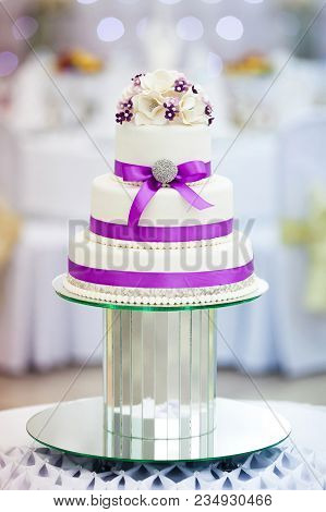 Wedding Cake With Flowers On The Wedding Banquet