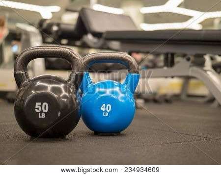 Row Of Kettlebells In A Modern Gym. 50 And 40 Lbs