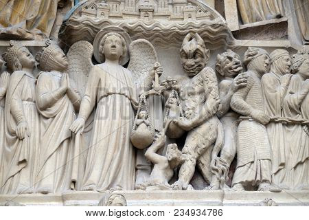 PARIS, FRANCE - JANUARY 04: Portal of the Last Judgment, Notre Dame Cathedral, Paris, UNESCO World Heritage Site in Paris, France on January 04, 2018.