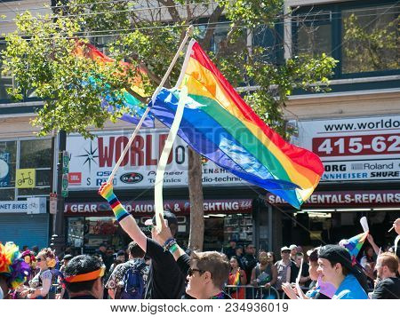 San Francisco, Ca - June 25, 2017: Flagbearer At The 2017 Sf Gay Pride Parade. Man Is Holding A Prid
