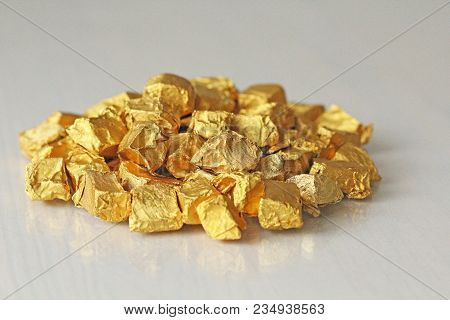 Ingots Or Nuggets Of Pure Gold. Gold Leaf. Tea Resin Puer.
