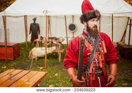 MOSCOW, RUSSIA - OCT 14, 2017: Russian strelets (shooter) with musket during historical reconstruction The Day of History in Sokolniki park.