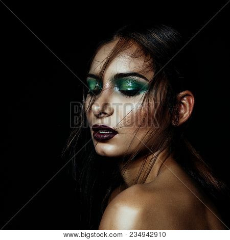 Dark Girl Portrait With Green Makeup And Deep Red Lips