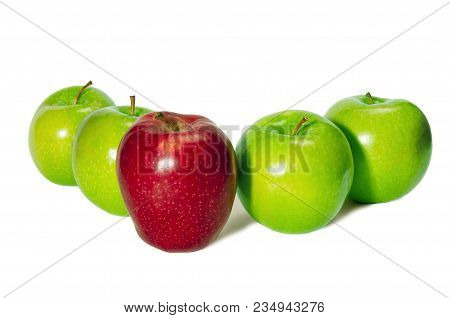 Horizontal Shot Of A Red Delicious Apple Standing In Front Of Four Green Granny Smith Apples On A Wh