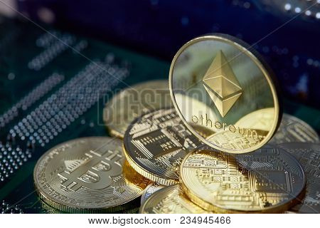 Golden Ethereum Coin Cryptocurrency On A Computer Mainboard, Selective Focus, Shallow Depth Of Field