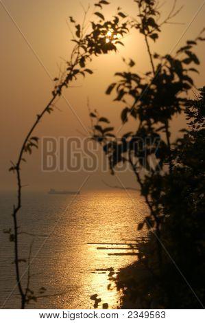 Dawn And Solar Beams. It Is A Black Sea.