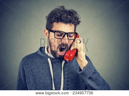 Young Angry Man Yelling On The Phone