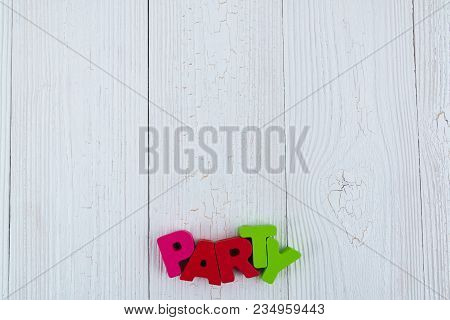Party Colorful Wooden Text On White Wooden Desk With Christmas Decorations, Merry Christmas And Happ
