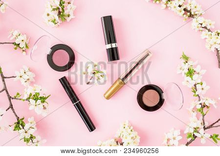 Woman Background. Spring Flowers And Feminine Cosmetic Isolated On Pink Background. Flat Lay, Top Vi