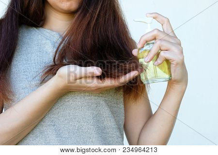 Female And Coconut Oil In Hand With Treatment Hair Damage, Hair Damage, Health And Beauty Concept.