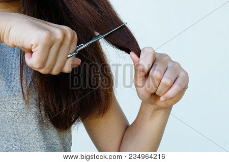 Female With Scissors In Hand Cuts Hair Damage,hair Damage, Health And Beauty Concept.