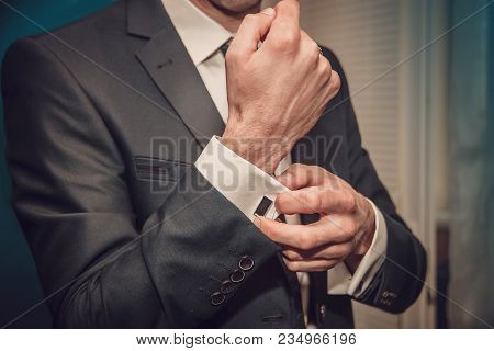 Man Is Putting On Cuff-links As He Gets Dressed In Formal Wear Close Up