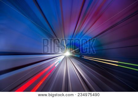 Speed Light From Train And Car In Tunnel With Long Speed Shutter. Use For Background Or Traffic Art