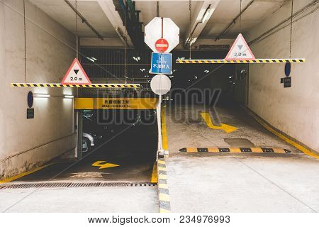 In Front Of Multi-level Car Parking Indoor In Apartment Buildings In Hong Kong. Entrance And Exit Wa