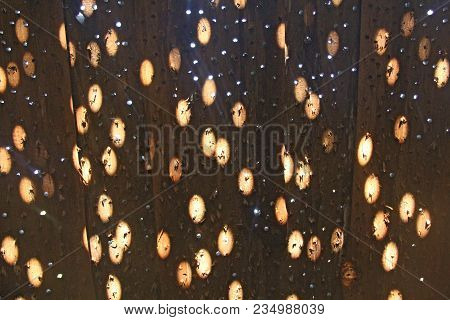 Sunny Background, Yellow Sunny Circles On The Wall. Sunny Round Glare From The Sun On A Wooden Wall