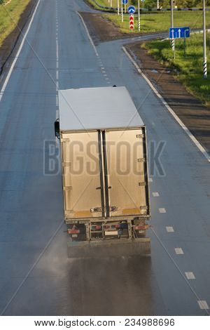 Truck Transports Freight On  Country Highway Photo