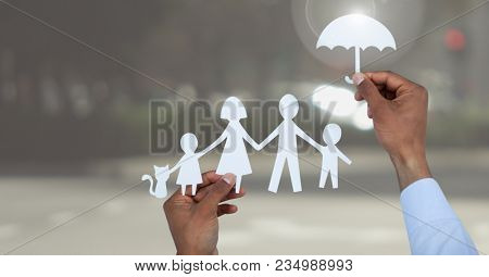 Cut outs family under protective umbrella