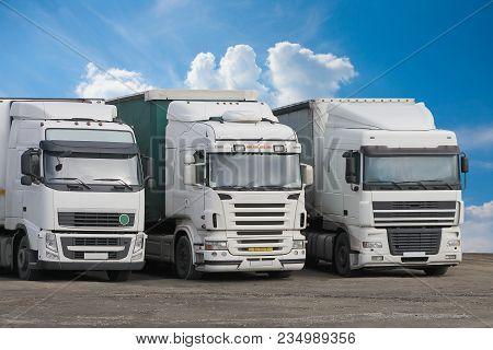 Trucks On Parking On Cloudy Sky Photo