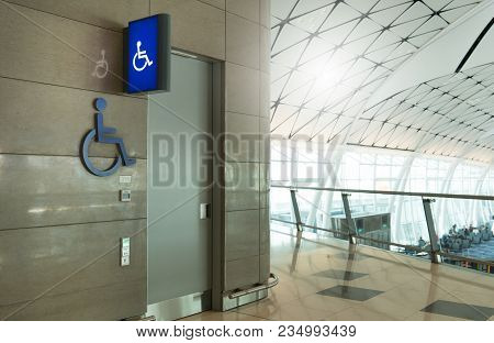 In Front Of Public Toilet Or Public Restoom For Men An Weman Disabled People With Disabled Sign Ligh