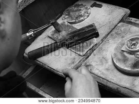 Black And White Photo Of The Jeweler. The Jeweler Turned On The Torch.