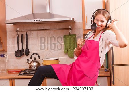 Cooking Preparing And Making Food Concept. Modern Beauty Woman Housewife Cook Chef Wearing Pink Apro