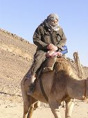 """camel talking to grand father : """"are you going to make it? """" in Sahara, Egypt poster"""