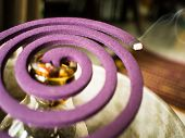 Mosquito coil is a purple lavender scent.Anti-dengue mosquito repellent during the rainy season.Abstract blur poster