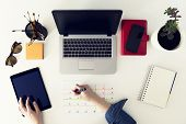 Calendar planner agenda schedule concept. Woman working in her office, planning. Freelance, graphic designer poster