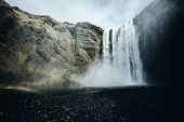 Amazing view of popular tourist attraction. Location famous Skogafoss waterfall, Skoga, Iceland, Europe. Scenic image of beautiful nature landscape. Summer background. Discover the beauty of earth. poster