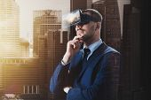3d technology, virtual reality, cyberspace and augmented reality concept - young businessman with singapore city on virtual headset or 3d glasses screen over double exposure effect background poster