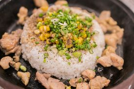 Chicken Pepper With Rice On Hot Plate On Top With Corn.