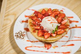 Toast With Icecream And Fresh Strawberry With Whipping Cream On White Plate