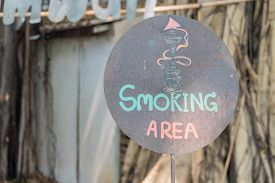 Sign Of Smoking Area In The City.