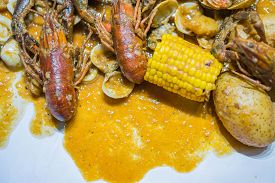 The Finger Licking Seafood And Corn In Dish.