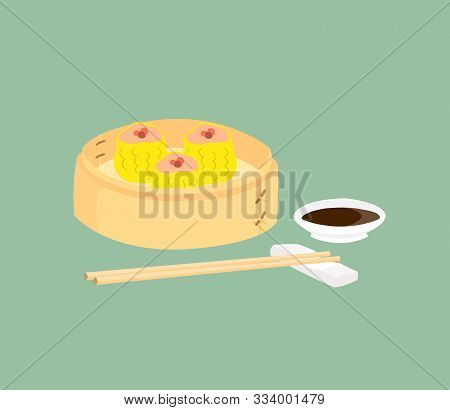Dim Sum In Bamboo Basket With A Cup Of Sauce And Chopsticks Placed On The Side. Dim Sum Are Favorite