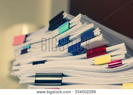 Pile Of Student Homework That Assigned To Student To Be Completed Outside Class On Teacher Desk Sepa