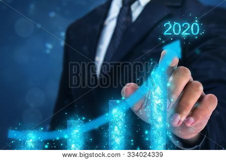 2020 Concept,business Man Point Hand On The Top Of Arrow Graph With High Rate Of Growth In Year 2020