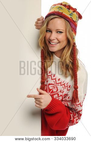 Young beautiful woman pointing at blank board isolated on a white background