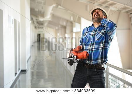 Construction worker getting hurt at work inside a building