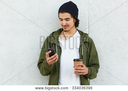 Portrait Of Peaceful Slender Youngster Posing Isolated Over White Wall Background Outdoors, Surfing