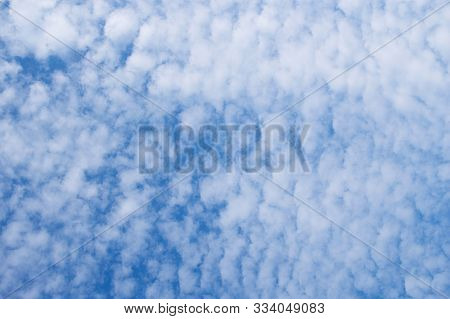 Feathery White Clouds In The Blue Sky In Detail