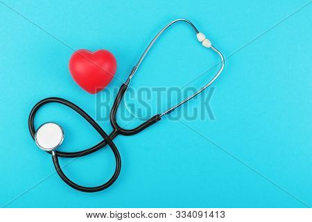 Red Heart And Stethoscope On A Blue Background. Health Care Concept, Health Worker, Heart Health Car