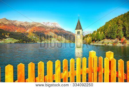 Fantasic Autumn View Of Submerged Bell Tower In Lake Resia. Location: Graun Im Vinschgau Village, La