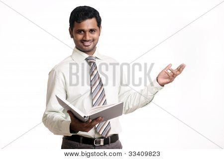 Indian business man with book