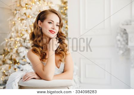 Young Beautiful Woman Smiling And Happy Looking Camera, Hair Styling Makeup, White Silver Color On B