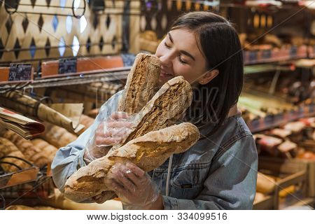Only The Best And Fresh Bakery. Young Woman In Supermarket With Fresh Bread . Health Food. Healthy F