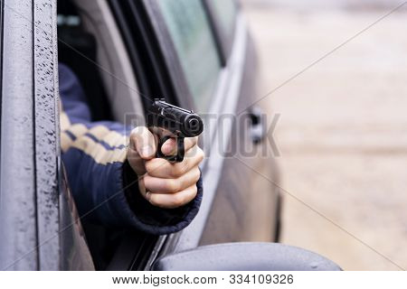 Man With A Gun Driving A Car, Male Hand With A Gun