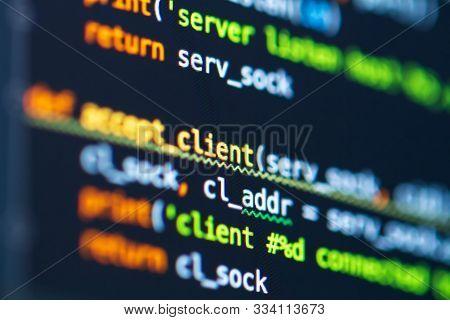 Program code on screen of laptop. Coding process. Software development. Developer programming web application server. Programming language poster